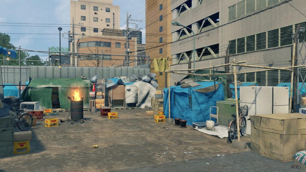 Screenshot einer Obdachlosensiedlung aus Yakuza: Like a Dragon